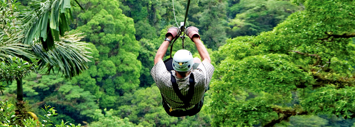 take a zipline adventure through rain forests in limon