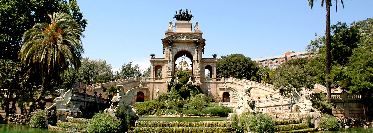 take photos next to beautiful fountains in barcelona