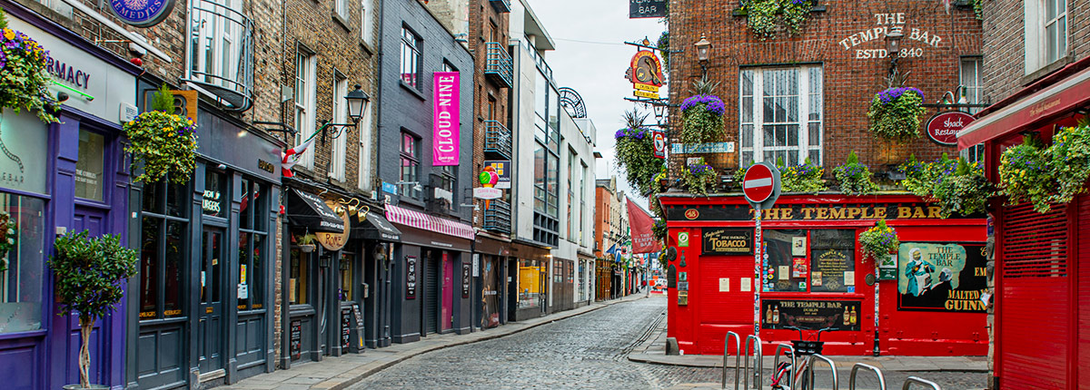 colorful buildings line a block in dublin