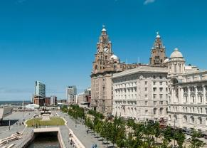 the three graces by the waterfront in liverpool, england