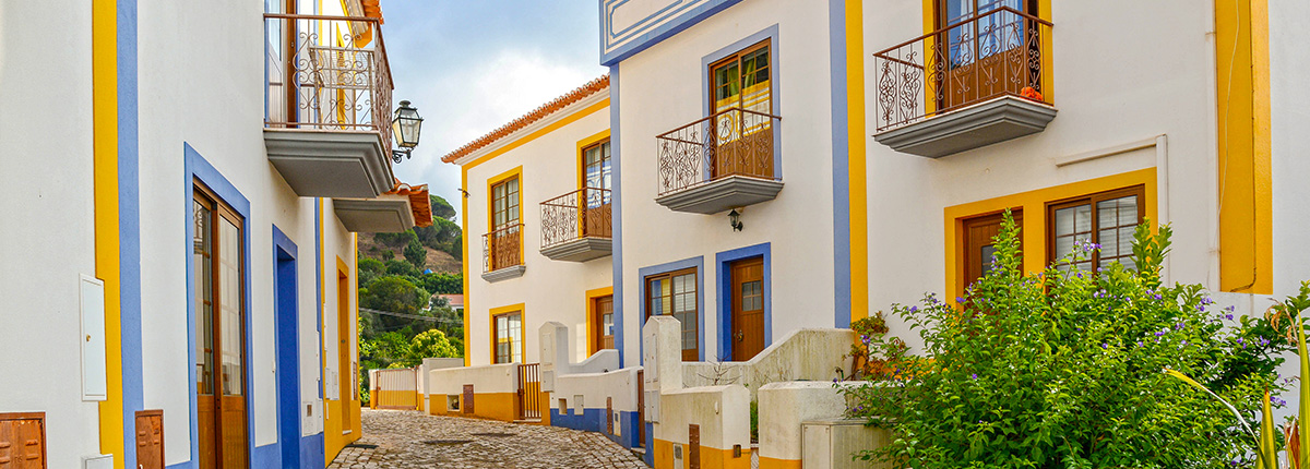 residential street with bright, colorful homes in portimao, portugal
