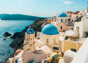white buildings along the teal coastline of santorini, greece