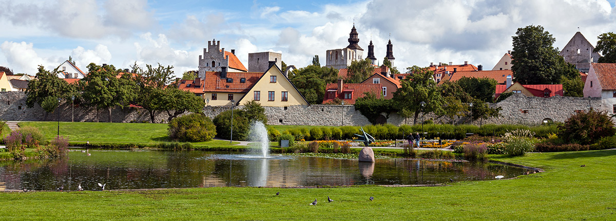 a beautiful park and medieval buildings in visby