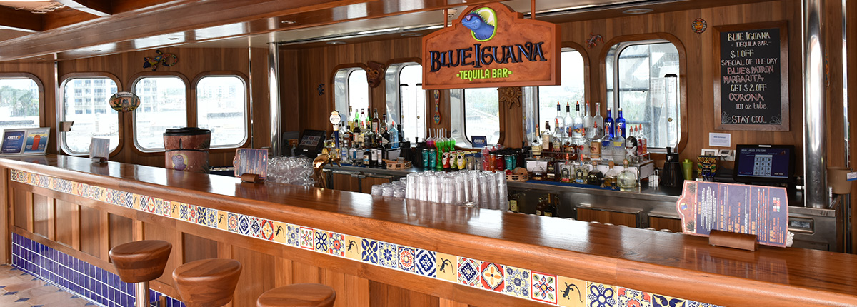 view of the blue iguana tequila bar onboard a carnival cruise