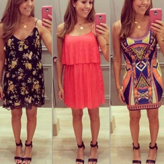 woman taking a mirror shot with phone wearing nine different outfits
