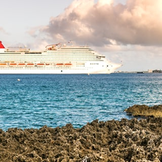 view of carnival ship from Jamaica rocky shore