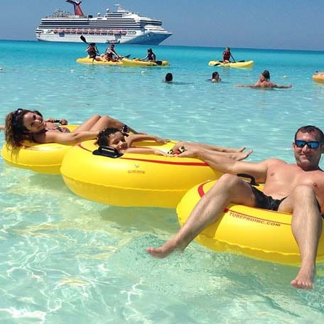 family on water floats in half moon cay