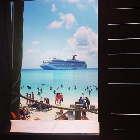 view of the beach and carnival ship at half moon cay