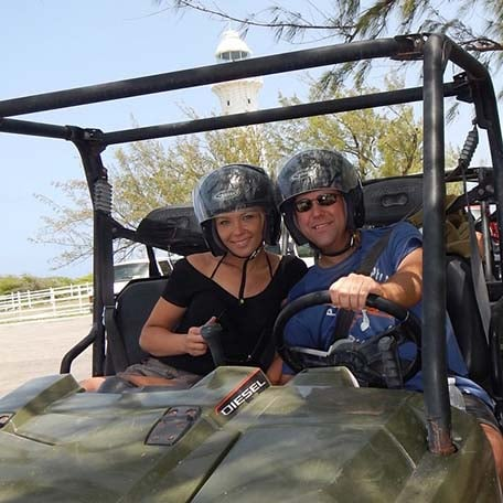 a couple enjoying the ATV excursion in grand turk