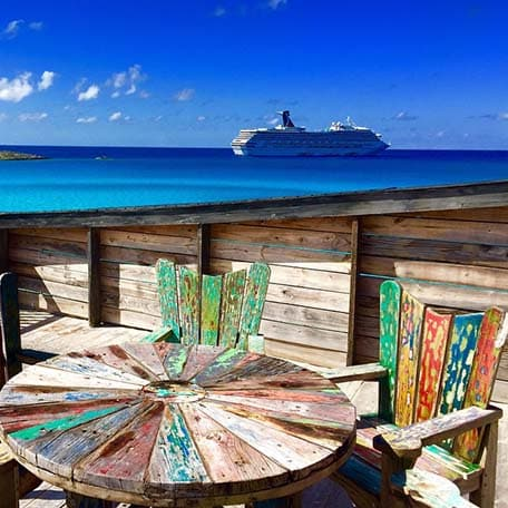 colorful table with a view of half moon cay
