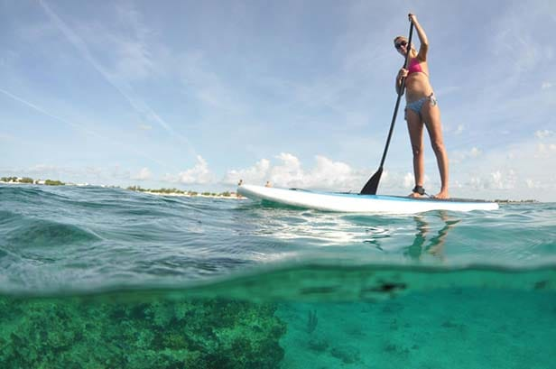 woman paddle boarding in grand turk