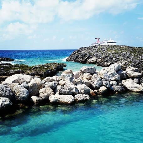 rocks along the water of half moon cay