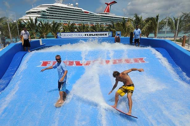 two guys surfing on the flowrider in grand turk