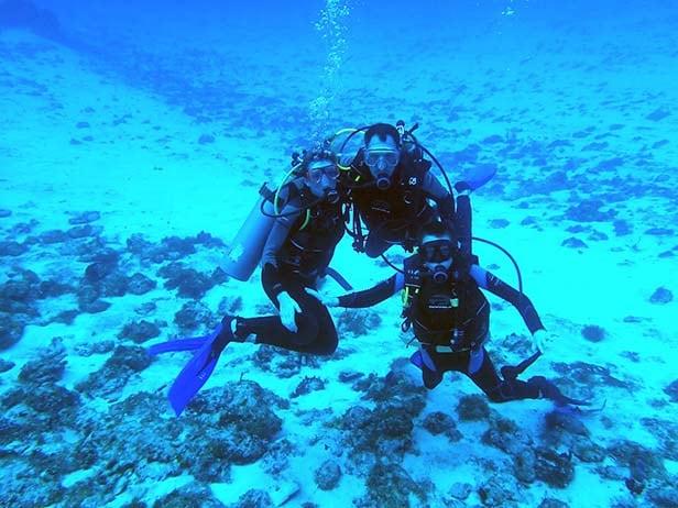 a family scuba diving