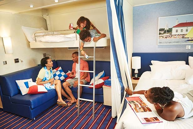 a family enjoying their carnival stateroom