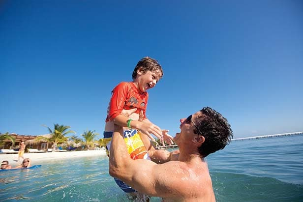 father and son playing in the water