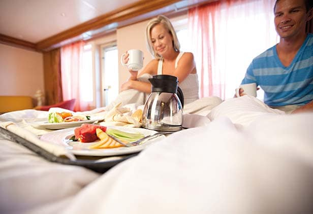 a couple enjoying room service breakfast