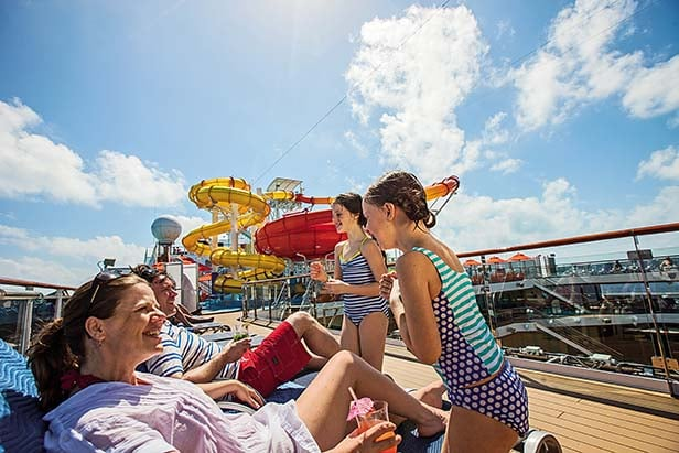 a family enjoying carnival's onboard activities