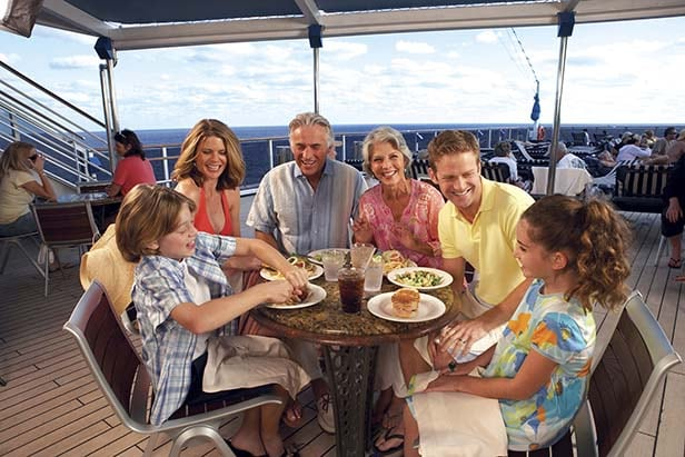 a family eating together on a carnival ship