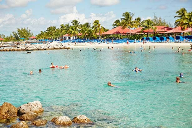 people swimming at the beach in princess cays