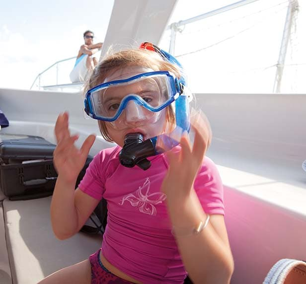 little girl wearing her snorkeling mask