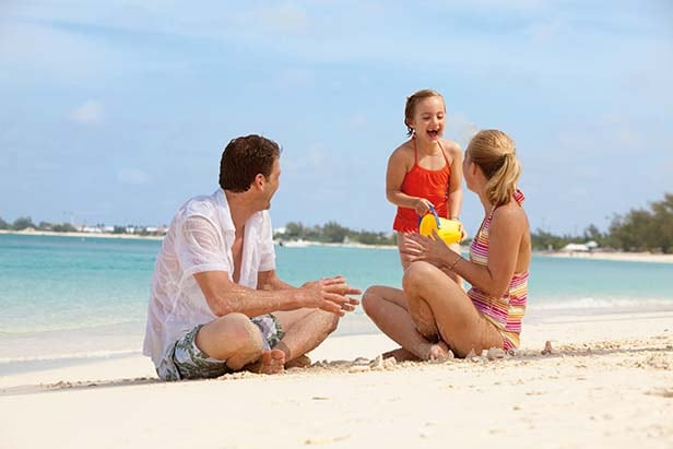 family playing on a Bahamas beach