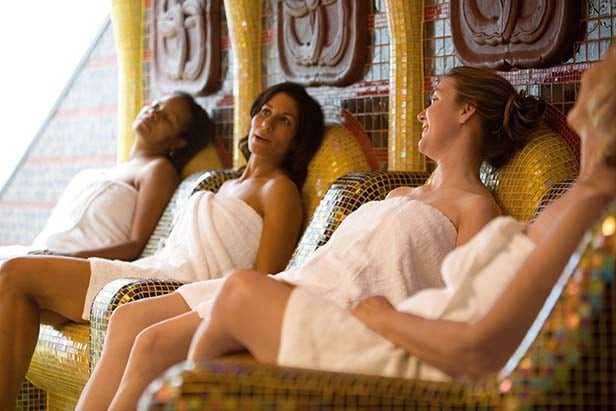 4 women enjoying the spa on a carnival ship
