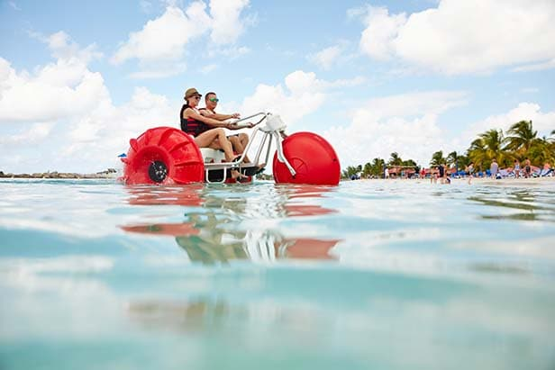 a couple riding an aqua bike in princess cays