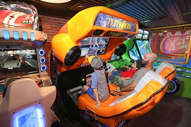 Man in arcade with his kids on the ship