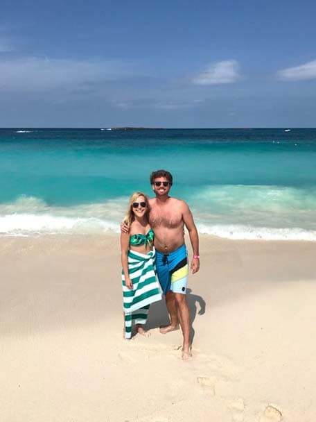 A medium shot of a couple on the beach at Nassau