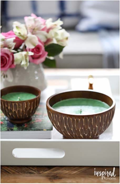 two candles on a white tray with flowers