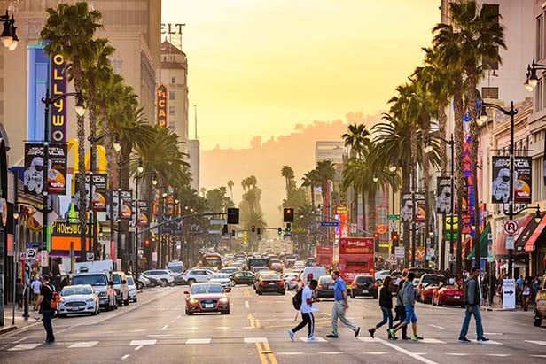 a busy Hollywood boulevard at sunset