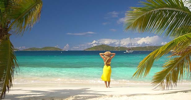 woman in a yellow sundress on a Caribbean beach