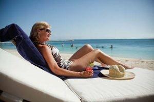 woman soaking up the sun on the beach