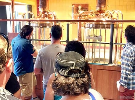 Several guests admiring the glass brew house at the entrance of Redfrog Pub and Brewery