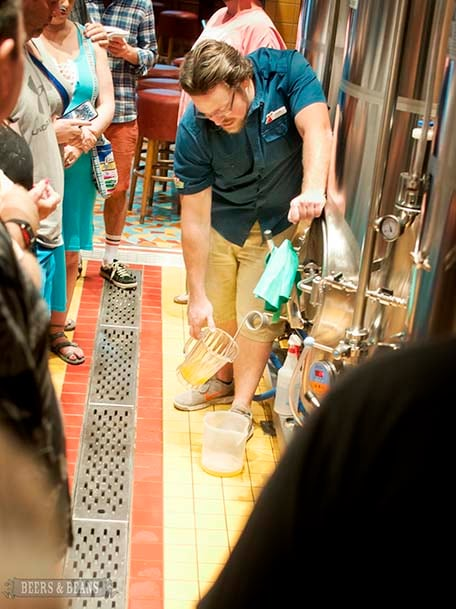 Brewmaster Colin Presby pouring fresh IPA straight into pitcher from the serving tank