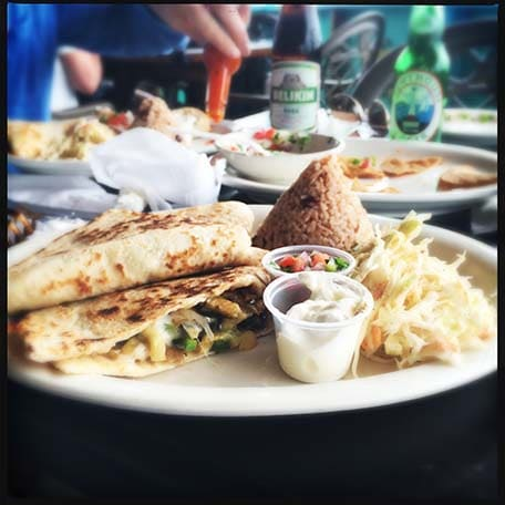 Plate with quesadilla, rice and sides in Caye Caulker, Belize