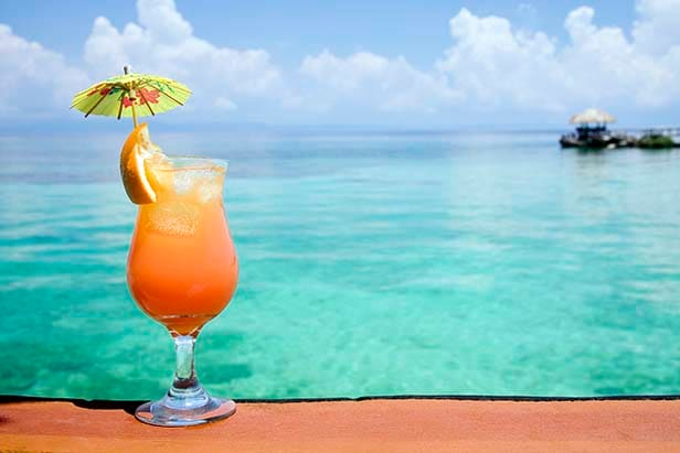 bahama mama drink with a view of the beach