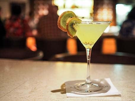 Kiwi Martini with fruit garnish at Alchemy Bar on carnival ship