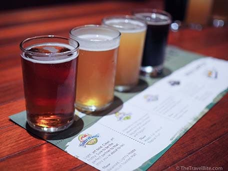 of four different beers at redfrog pub and brewery on carnival ship