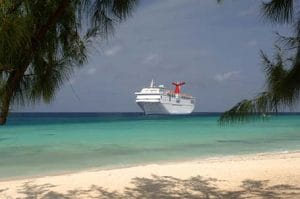 Carnival cruise ship in front of a Caribbean beach