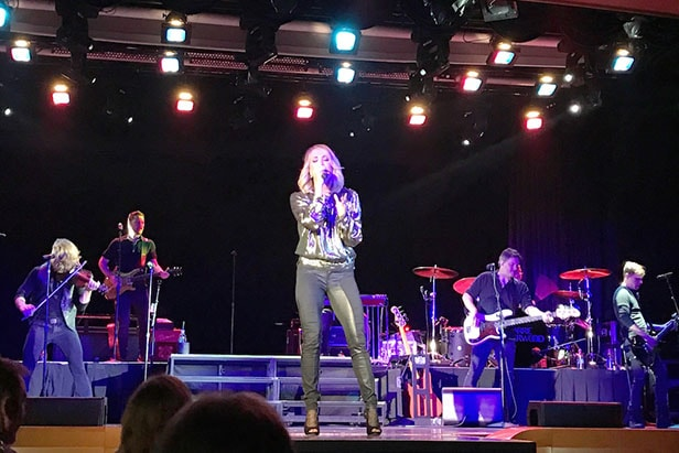 Carrie Underwood performing on stage on Carnival Imagination for Carnival LIVE