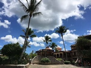Altos de Chavon village in La Romana, Dominican Republic with palm trees and blue cloudy sky