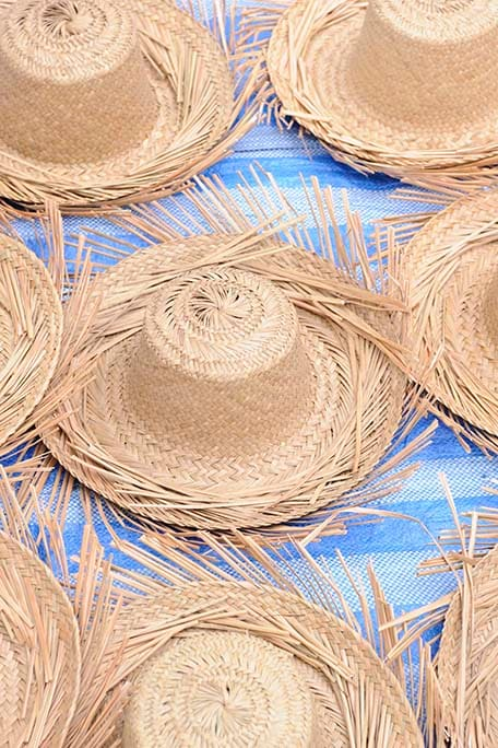 straw hats in a local bahamian market