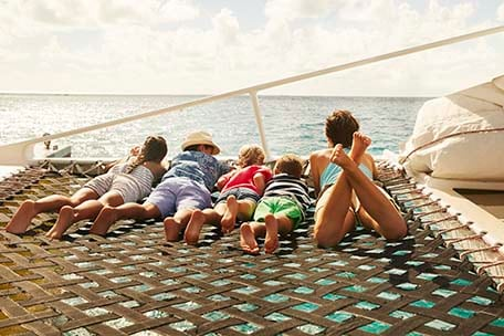 family sailing on a catamaran during a shore excursion