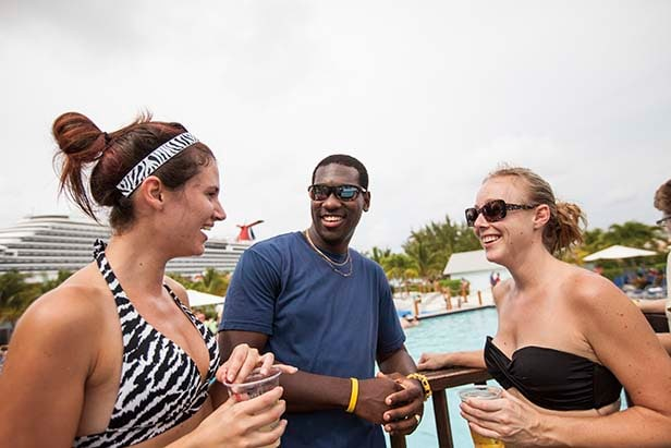 a group of friends enjoy drinks by the pool in grand turk