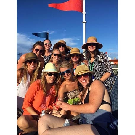 group of friends pose on a cruise