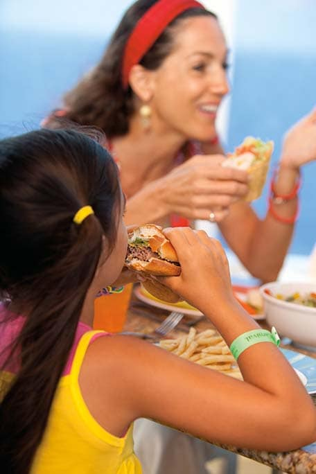 family enjoying burgers and burritos onboard