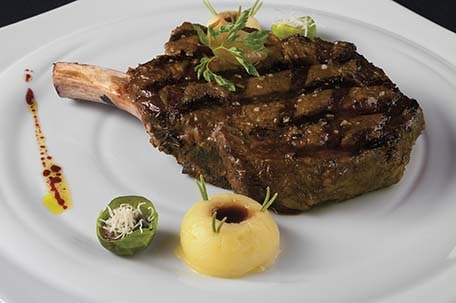 a tasty prime rib chop from the onboard steakhouse