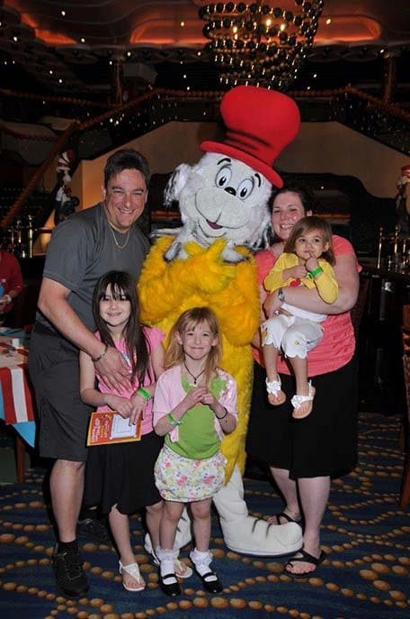 family posing with the cat in the hat onboard